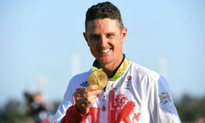 Aug 14, 2016; Rio de Janeiro, Brazil; Justin Rose (GBR) shows off his gold medal in a medal ceremony for men's individual golf at Olympic Golf Course during the Rio 2016 Summer Olympic Games. Mandatory Credit: Michael Madrid-USA TODAY Sports